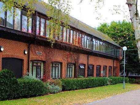 Who will run Stantonbury International School now?