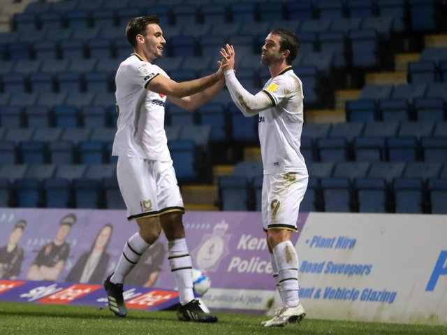Warren O'Hora celebrates his goal with Will Grigg