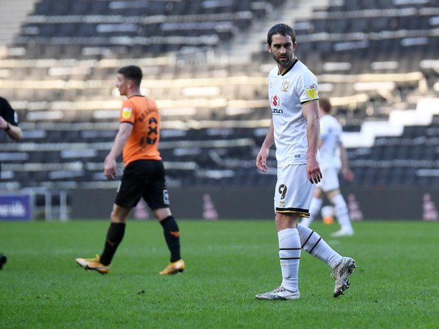 Will Grigg in action for MK Dons