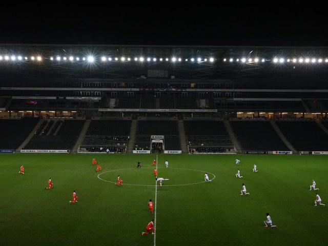 MK Dons warmed up and kicked towards the opposite end in the first half against Blackpool to where they usually do