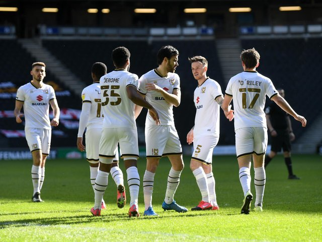 MK Dons celebrate the opener against Accrington on Saturday