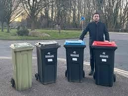 Council leader Pete Marland with the bins