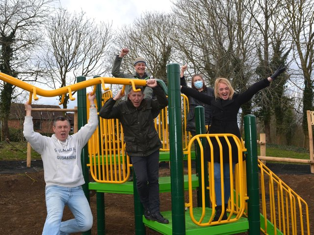 Childminder Sam Simmons tries out the new play equipment with fellow campaigners