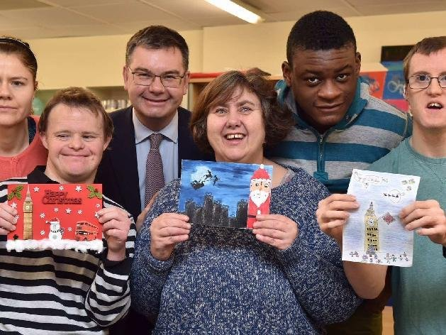MP Iain Stewart supports MK SNAP and is pictured with some of the learners
