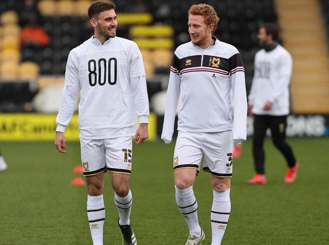 Dean Lewington with Warren O'Hora as he marked the captain's 800th appearance