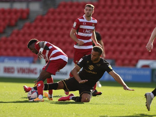 Carlton Morris goes in for a challenge against Doncaster Rovers