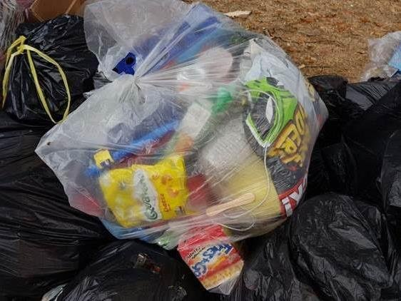 Can you spot the 'contaminated' items in this recycling sack?