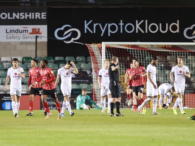 Lincoln celebrating after one of their four second-half goals at Sincil Bank on Tuesday night