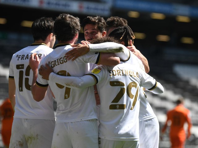 MK Dons celebrate Scott Fraser's goal against Portsmouth