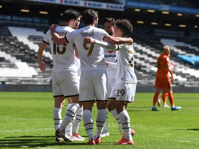 MK Dons celebrate Scott Fraser's penalty