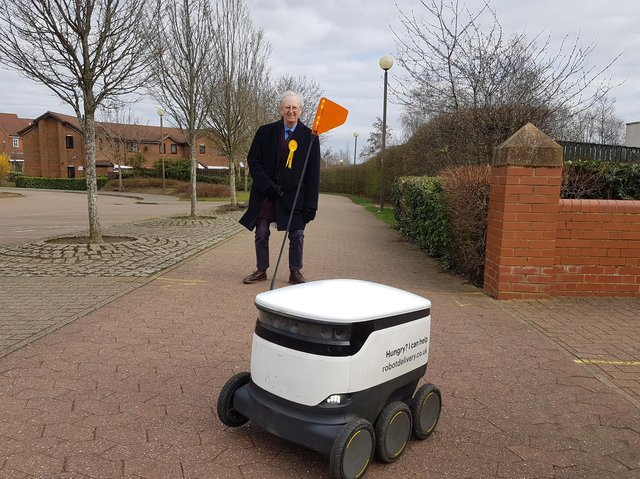 John Howson with a delivery robot in Milton Keynes