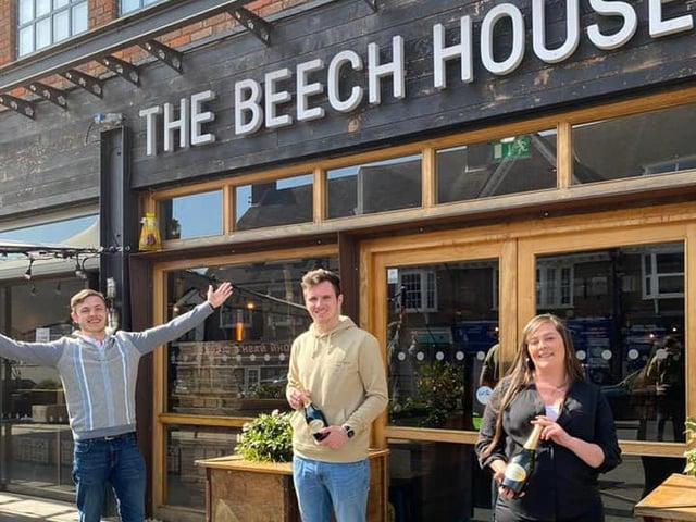 Beech House Amersham's gm Jamie Firminger congratulating new assistant Managers George Muddiman & Rebecca Gilbert.