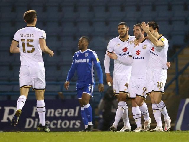 Dons celebrate Will Grigg's goal against Gillingham