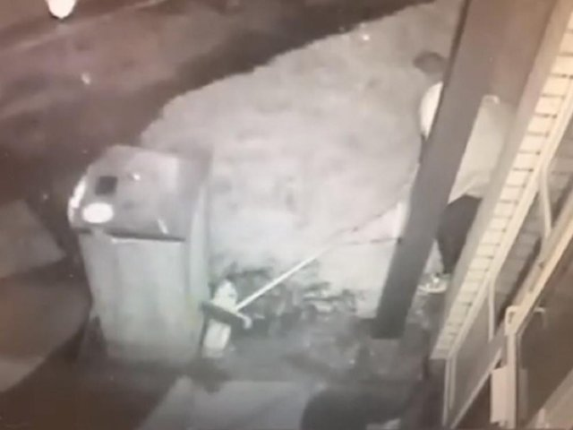 The thief using a broom to steal milk is caught on CCTV