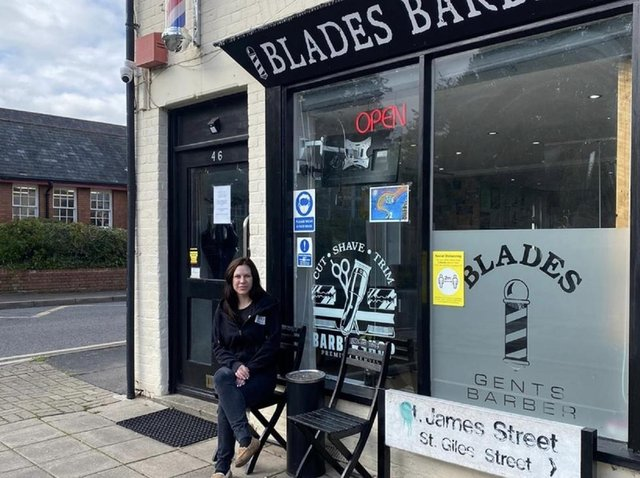 Cass outside her barbers shop
