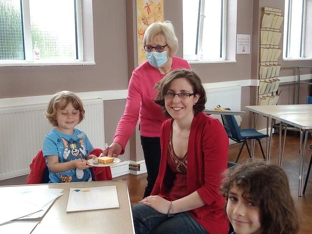 Volunteer Lynda Castle serves some customers