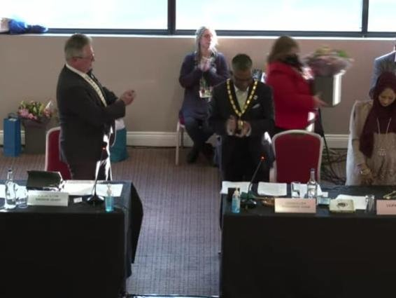 Cllr Andrew Geary, left, applauds his successor Cllr Mohammed Khan