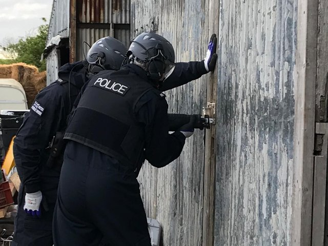 Thames Valley Police completing a drugs raid on May 26