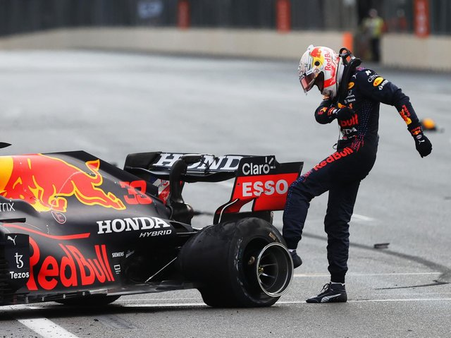 Max Verstappen shows his frustration after his tyre blows