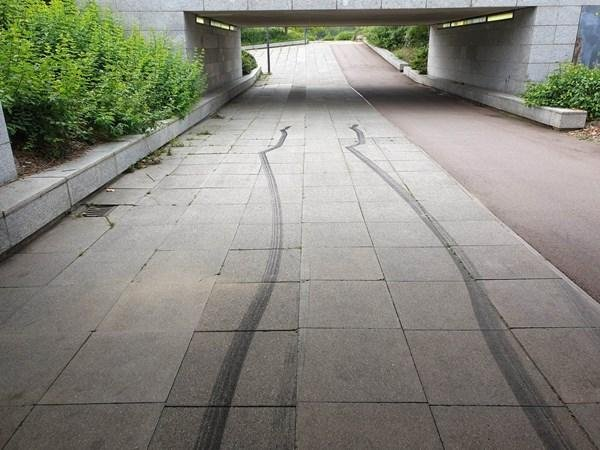 Skid marks left behind under a city underpass