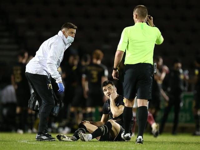Simon Crampton gives treatment to Scott Fraser