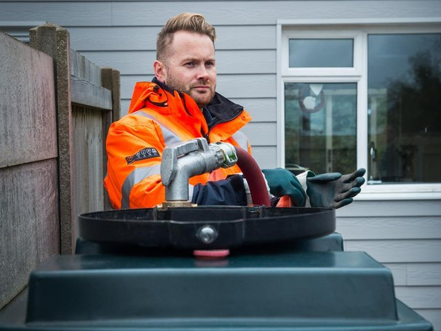An HVO supplier filling up a tank with the new, fossil free liquid fuel