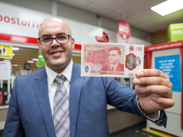 Bletchley Postmaster Ahmed Butt with the new note