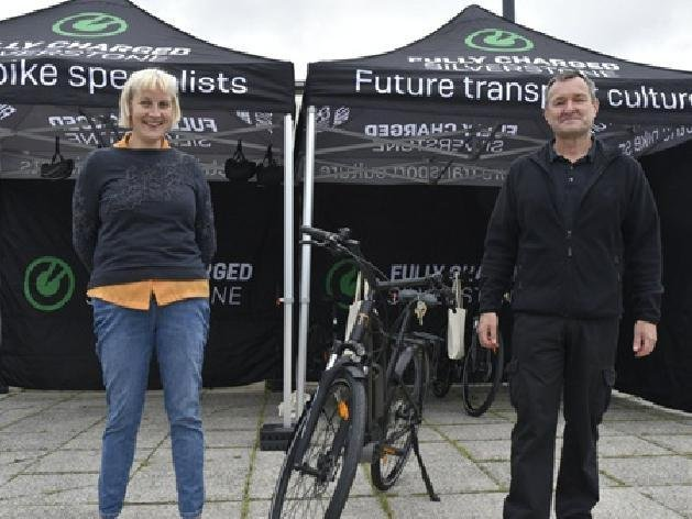 Cllr Jenny Wilson-Marklew  hands over an eBike to MK's first new loanee, Geof